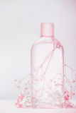 Bottle with lotion, tonic or micellar cleansing water , natural cosmetic product or beauty concept on pastel background. Front view Royalty Free Stock Image