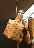 Bottle made of birch bark hanging by a thread Stock Photos
