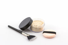 Bottle of make up powder with powder puff and brush. Stock Photos