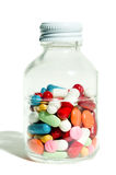 Bottle of many pills Stock Photography
