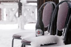 Bottle of Martini Asti stands on a chair covered with hoarfrost stock images