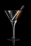 Bottle in martini glass Royalty Free Stock Image