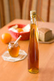 Bottle of mead - honey products. Bottle of mead with other natural product behind. Selective focus stock photography