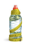 Bottle and measuring tape Stock Photography