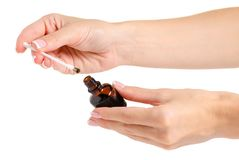 Bottle of medicine Iodine in the hand. On a white background isolation stock photography