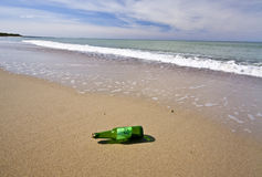 Bottle with the message. Thrown out on a sandy beach Stock Photo