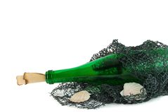 Bottle with message. Green bottle with message in the fishing net stock photo