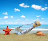 Bottle with a message on beach Royalty Free Stock Photo