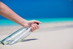 Bottle with a message buried in the white sand Stock Photography