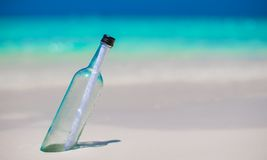 Bottle with a message buried in the white sand Royalty Free Stock Photos