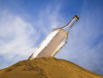 Bottle with message on cloudy sky background Stock Photo