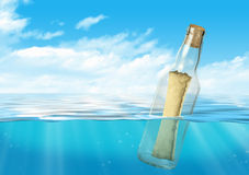 Bottle with message float at ocean Stock Photography