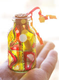 Bottle with a message in hand Stock Images