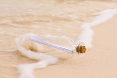 Message  in a bottle. Bottle with a message  on sand beach Stock Images