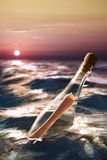 Bottle with a message at sea. Message in a bottle at sea Stock Image