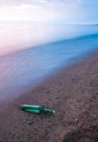 Bottle with the message on sea coast Stock Photography
