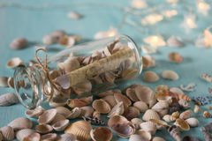 Bottle with a message, seashells. Royalty Free Stock Image