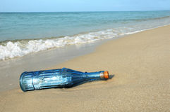 Bottle with Message on Shore stock images
