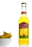 Bottle of Mexican Desperados beer with nachos Stock Image