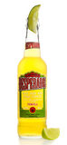 Bottle of Mexican Desperados Tequila beer with lime wedge Stock Photo