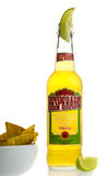 Bottle of Mexican Desperados Tequila beer with lime wedge and na Stock Photos