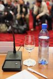 Bottle, microphone, glass and pen on table Royalty Free Stock Photo