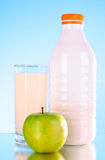 Bottle of milk and apple Stock Image