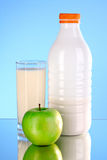 Bottle of milk and apple Stock Photo
