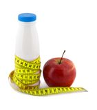 Bottle milk apple measure tape Royalty Free Stock Image
