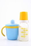 Bottle of milk and baby cup Stock Image