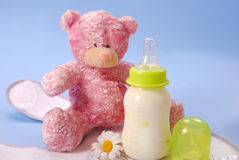 Bottle of milk for baby and teddy bear Stock Photography