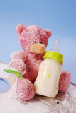 Bottle of milk for baby and teddy bear Stock Photos