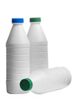 Bottle of milk with a caps colored Stock Image