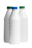 Bottle of milk with a caps colored isolated Royalty Free Stock Photos