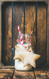 Bottle with milk and Christmas festive gingerbread star shaped cookies Royalty Free Stock Images