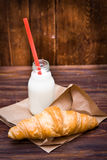 Bottle of milk and croissant Royalty Free Stock Photo