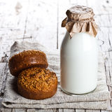 Bottle of milk and fresh baked bread Stock Photos