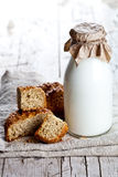 Bottle of milk and fresh baked bread Stock Image