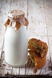Bottle of milk and fresh baked bread Stock Photo