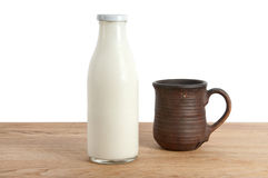 A bottle of milk and mug Stock Photos