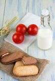 Bottle of milk next to whole wheat biscuits Royalty Free Stock Images