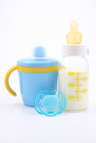 Bottle of milk and pacifier Stock Image