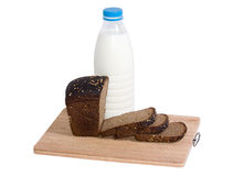 Bottle of milk and rye bread Royalty Free Stock Photo