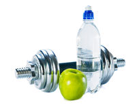Bottle of mineral water, dumbbells  and  apple Royalty Free Stock Images