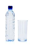 Bottle of mineral water and empty glass Royalty Free Stock Photo