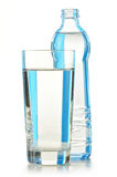 Bottle of mineral water and glass Royalty Free Stock Photography