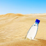 Bottle of mineral water on the sand Royalty Free Stock Photography