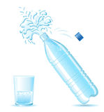 Bottle of mineral water splashing and glass  isola Stock Images