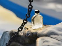 Bottle of modern male perfume. Bottle of modern male perfume on color background Royalty Free Stock Images