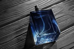 Bottle of modern male perfume. On dark wooden background Stock Image